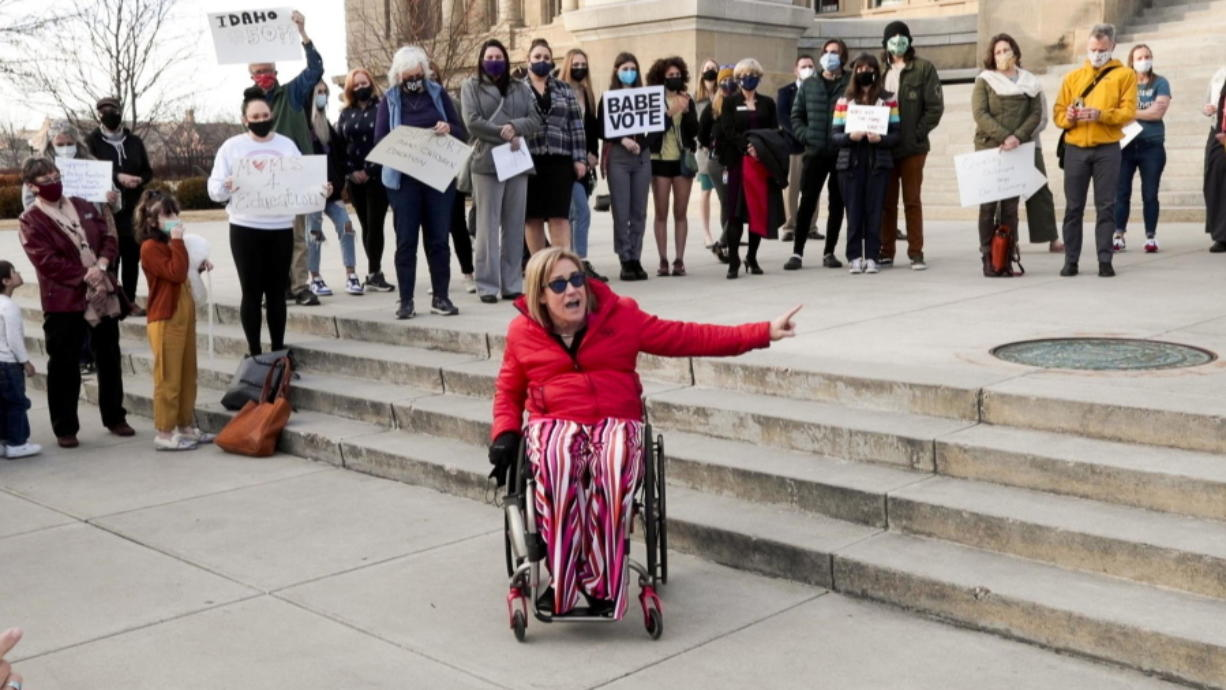 State Rep. Muffy Davis, D-Ketchum, rallies demonstrators at the Idaho Statehouse on Wednesday in Boise, Idaho. They decried the decision to kill a bill would have would provided $6 million in federal grants for early childhood education.