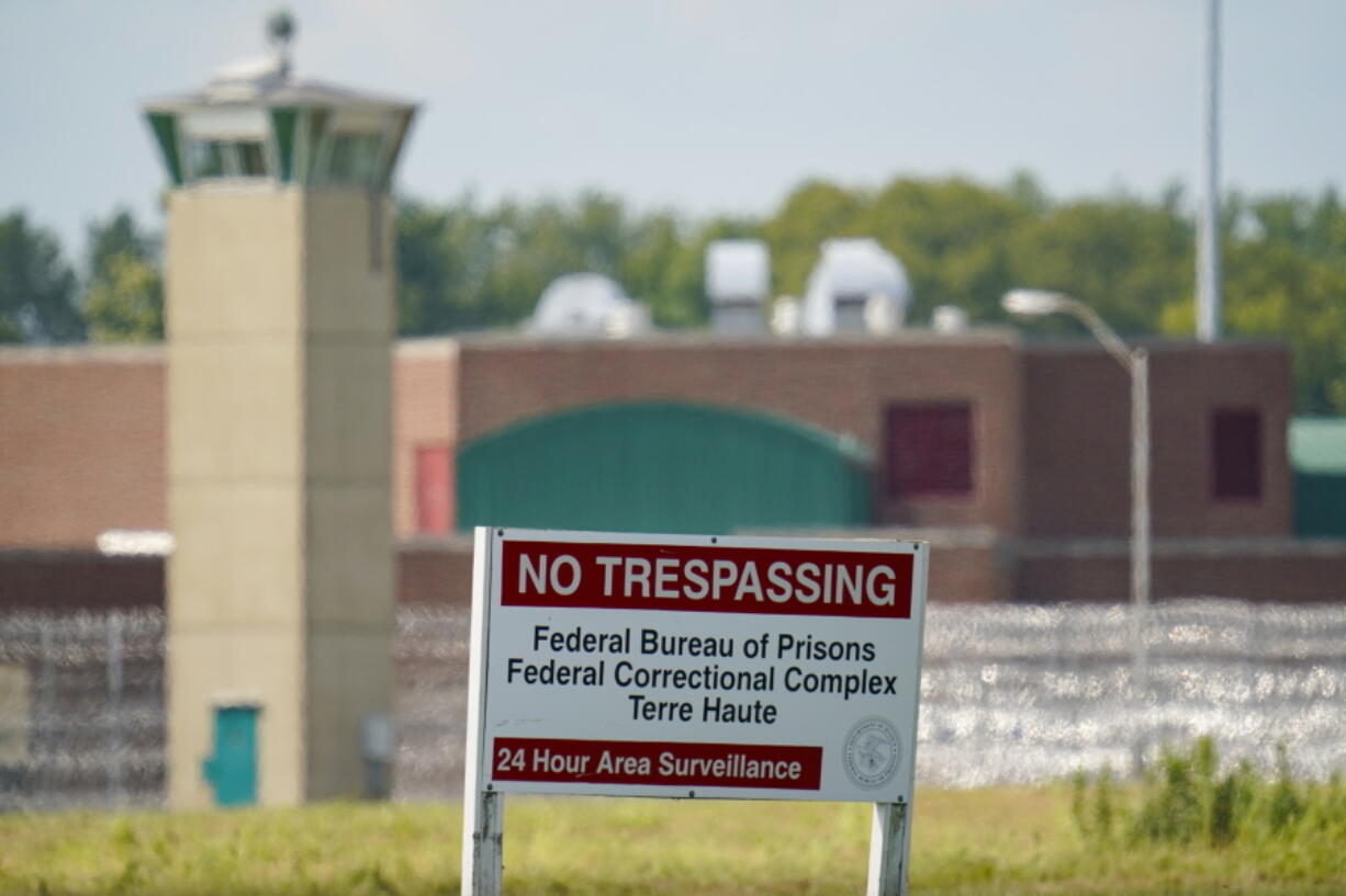 FILE - This Aug. 26, 2020 file photo shows the federal prison complex in Terre Haute, Ind. Inmates on federal death row tell The Associated Press that a leading topic of conversation through airducts they use to communicate is whether President Joe Biden will keep a campaign pledge to halt federal executions. Biden hasn't spoken publicly to that question since taking office four days after the Trump administration executed the last of 13 inmates at the Terre Haute prison where federal death row is located.