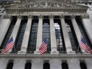FILE - In this Nov. 23, 2020 file photo, the New York Stock Exchange is seen in New York.  Stocks are opening higher on Wall Street at the end of an up-and-down week, led by gains in banks and energy companies.   The index was up 0.5% early Friday, March 26, 2021.