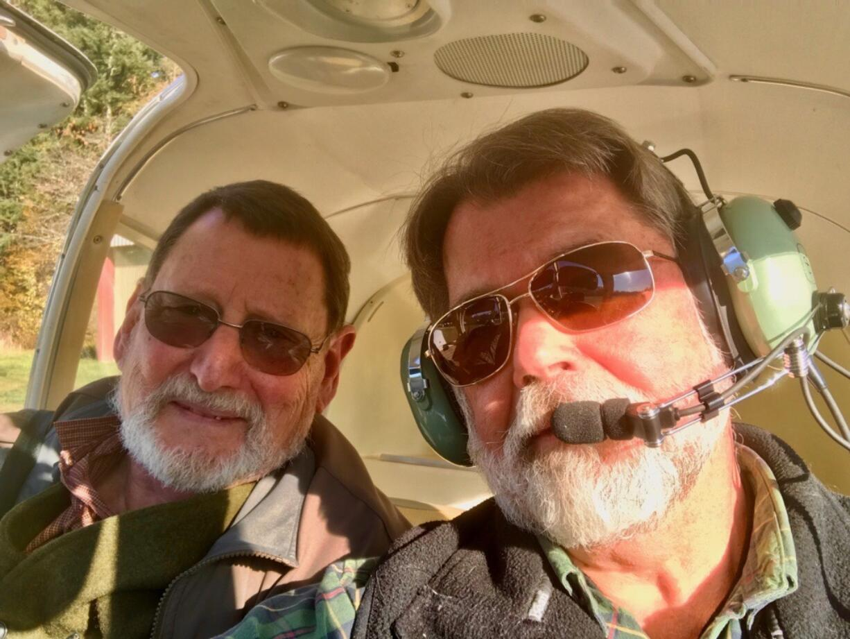 Flying partners Truman O'Brien, left, and Craig Beles walked away from a crash in a forest near the Clark-Skamania county line on Monday.