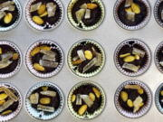 A recipe of chocolate tahini cups, made with 100 percent cacao chocolate chips, is displayed in Alexandria, Va., on Oct. 18, 2020.  There's more to cacao than chocolate. The cacao fruit and pulp can be used for cooking as well.