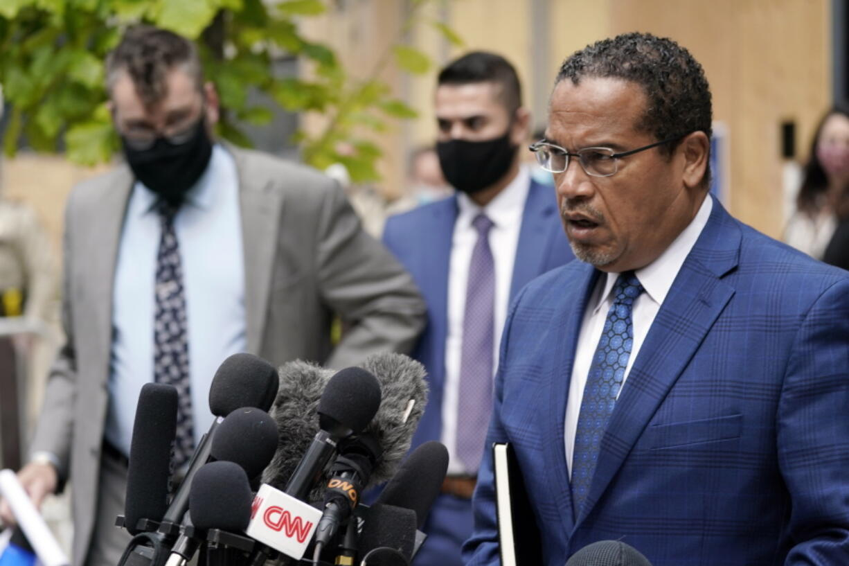 FILE - In this Sept. 11, 2020 file photo, Minnesota Attorney General Keith Ellison, right, addresses reporters outside the Hennepin County Family Justice Center in Minneapolis. Jury selection begins Monday, March 8, 2021, for Derek Chauvin, a former Minneapolis police officer charged with murder and manslaughter in George Floyd's death. Ellison is the lead prosecutor in the case.