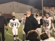 Coach Rick Steele addresses his team after its 24-14 victory Friday over Washougal.