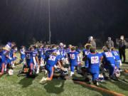 Ridgefield football coach Scott Rice talks to his team after a 49-0 win over Mark Morris on Friday at Ridgefield High School.