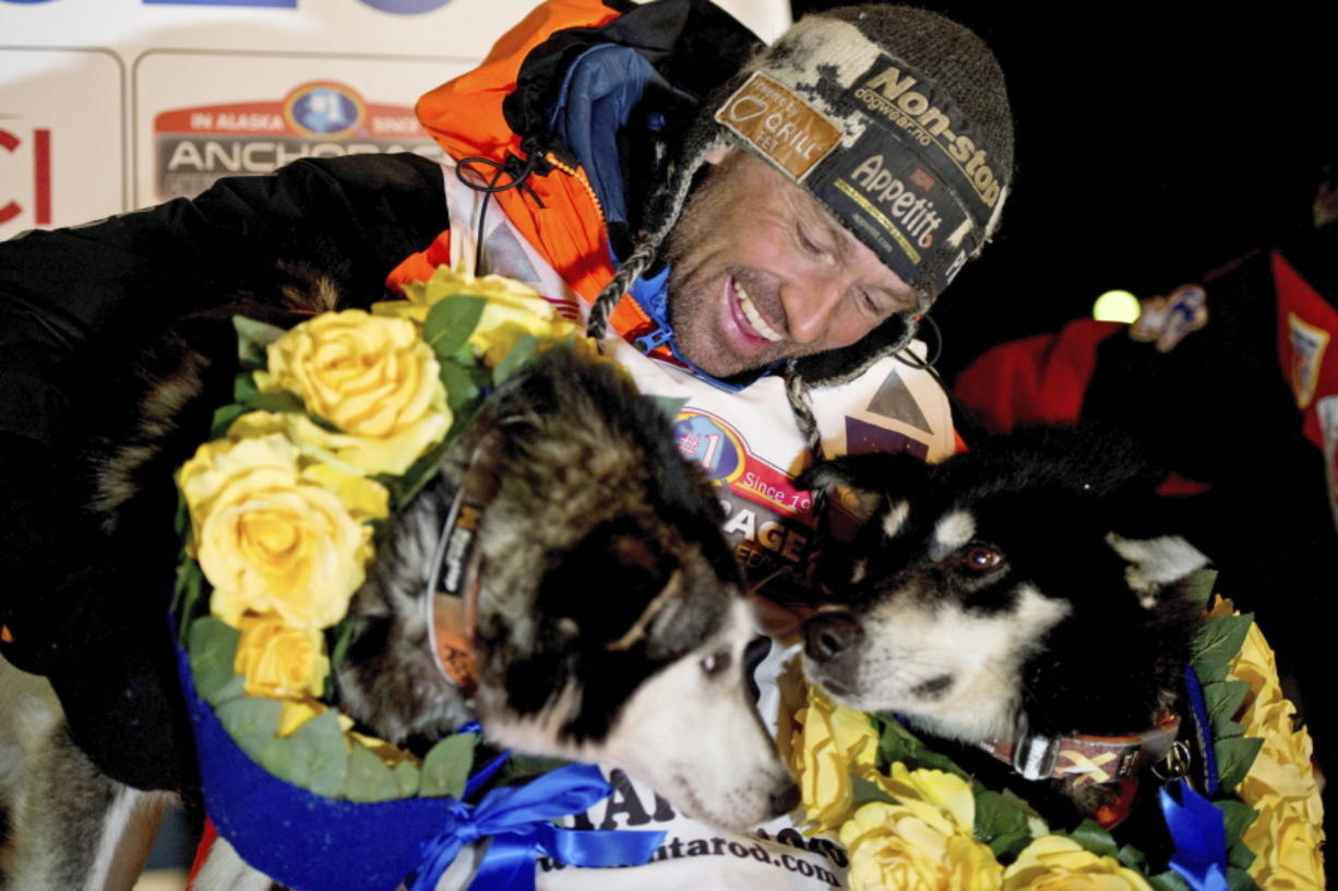 Thomas Waerner, of Norway, celebrates his win in the 2020 Iditarod Trail Sled Dog Race in Nome, Alaska. The world's most famous sled dog race starts Sunday, March 7, 2021, without its defending champion in a contest that will be as much dominated by unknowns and changes because of the pandemic as mushers are by the Alaska terrain.