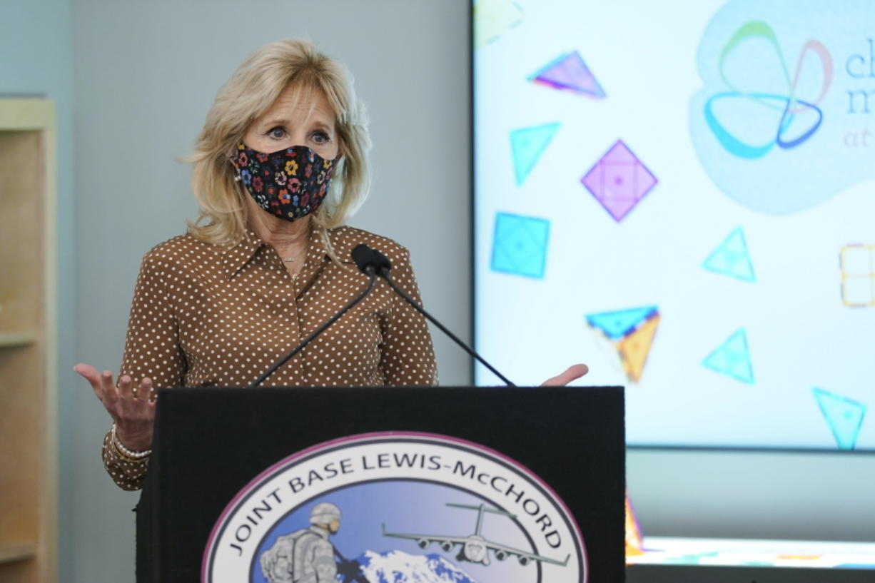 First lady Jill Biden speaks during a tour of the new children's museum at Joint Base Lewis-McChord, Tuesday, March 9, 2021, in Washington state. Biden also visited with military families during her visit. (AP Photo/Ted S.