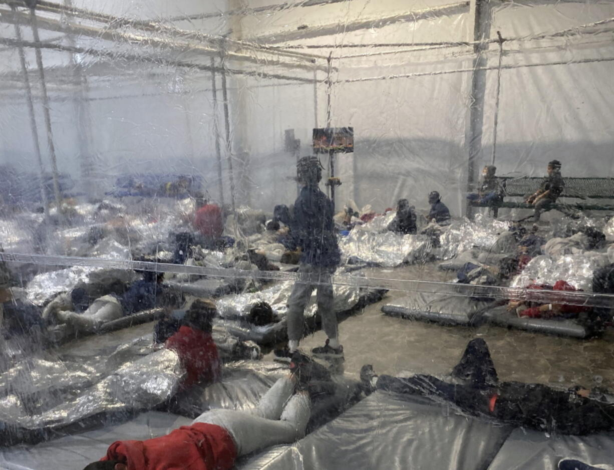 This March 20, 2021, photo provided by the Office of Rep. Henry Cuellar, D-Texas, shows detainees in a Customs and Border Protection (CBP) temporary overflow facility in Donna, Texas. President Joe Biden's administration faces mounting criticism for refusing to allow outside observers into facilities where it is detaining thousands of immigrant children.  (Photo courtesy of the Office of Rep.
