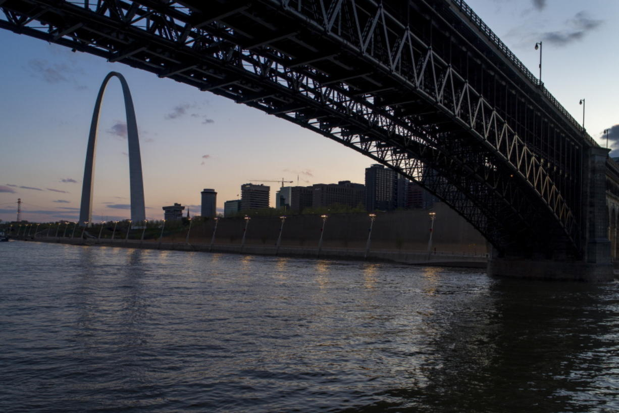 FILE - The Eads Bridge crosses the Mississippi River from Illinois to Missouri as the sun sets beyond the Gateway Arch, Tuesday, April 14, 2020, in St. Louis. Cities along the Mississippi River will take part in a global system to determine where plastic pollution comes from and how it ends up in waterways as a first step toward solving the problem, officials said Wednesday, March 3, 2021.