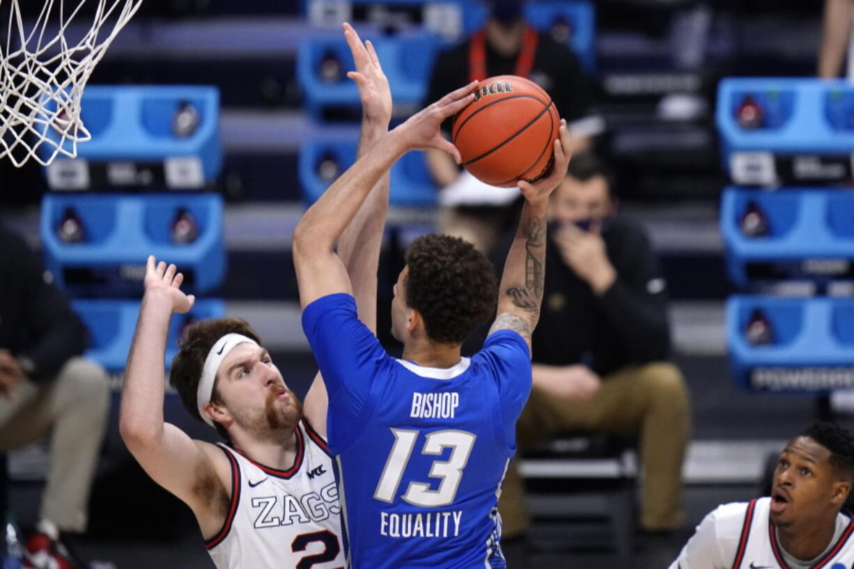 Creighton forward Christian Bishop (13) drives on Gonzaga forward Drew Timme (2) in the first half of a Sweet 16 game in the NCAA men's college basketball tournament at Hinkle Fieldhouse in Indianapolis, Sunday, March 28, 2021.