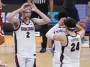 Gonzaga forward Drew Timme (2) celebrates with teammate Corey Kispert (24) after defeating Oklahoma in the second round of the NCAA college basketball tournament at Hinkle Fieldhouse in Indianapolis, Monday, March 22, 2021.