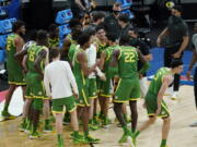 Oregon players celebrate following a second-round game against Iowa. in the NCAA men's college basketball tournament at Bankers Life Fieldhouse, Monday, March 22, 2021, in Indianapolis. Oregon won 95-80.