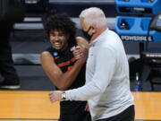 Oregon State guard Ethan Thompson (5) and head coach Wayne Tinkle celebrate beating Oklahoma State 80-70 after a men's college basketball game in the second round of the NCAA tournament at Hinkle Fieldhouse in Indianapolis, Monday, March 22, 2021.