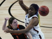 Oregon State guard Aleah Goodman, left, passes around South Carolina forward Aliyah Boston, right, during the second half of a college basketball game in the second round of the women's NCAA tournament at the Alamodome in San Antonio, Tuesday, March 23, 2021.