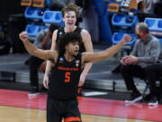 Oregon State guard Ethan Thompson (5) reacts to a basket against Tennessee during the second half of a men's college basketball game in the first round of the NCAA tournament at Bankers Life Fieldhouse in Indianapolis, Friday, March 19, 2021.