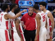 Houston head coach Kelvin Sampson talks to his team in the first half of a Sweet 16 game against Syracuse in the NCAA men's college basketball tournament at Hinkle Fieldhouse in Indianapolis, Saturday, March 27, 2021.