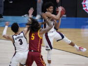 Gonzaga guard Aaron Cook, grabs a rebound over Southern California guard Isaiah White (5) during the first half of an Elite 8 game in the NCAA men's college basketball tournament at Lucas Oil Stadium, Tuesday, March 30, 2021, in Indianapolis.