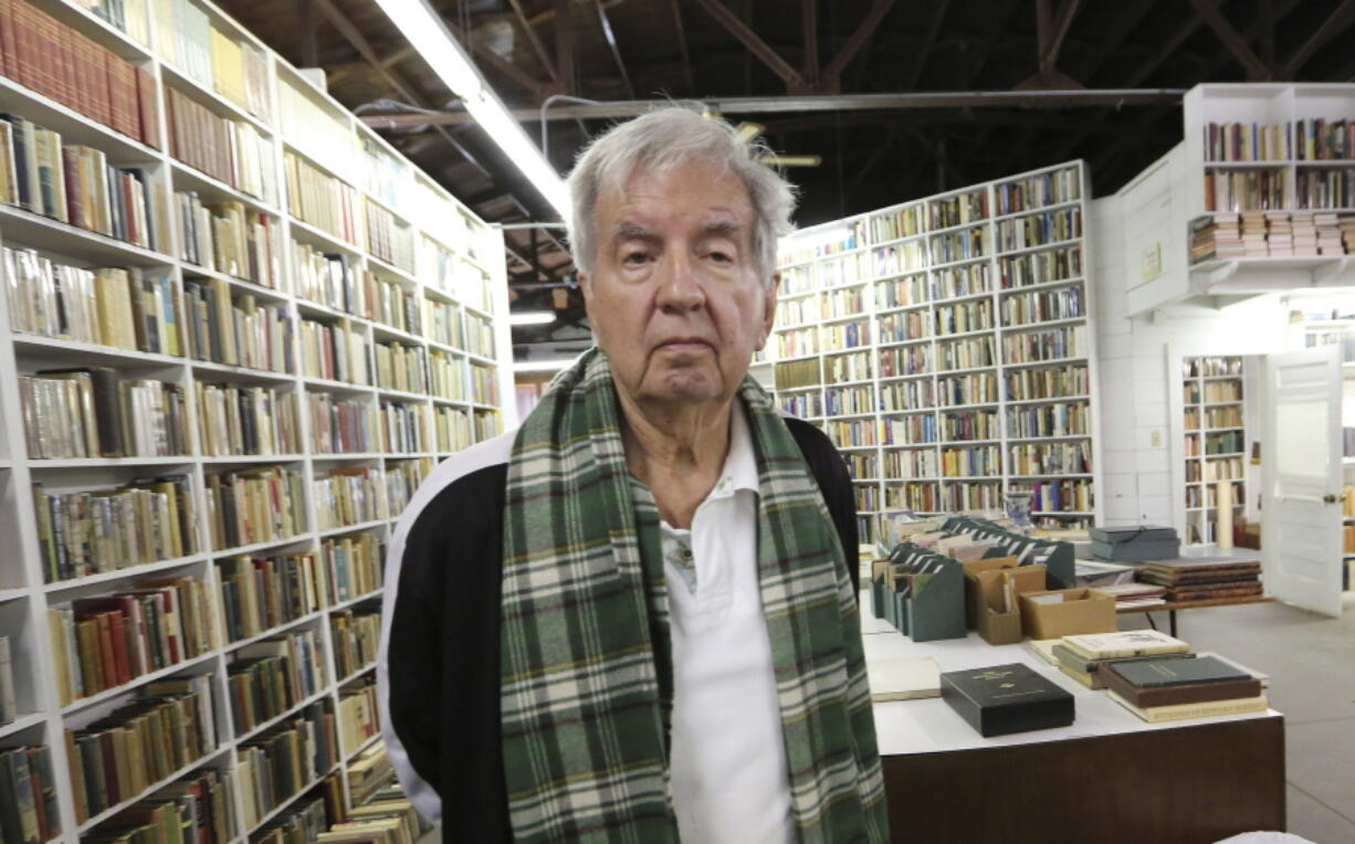 FILE - In this April 30, 2014, file photo, Pulitzer Prize-winning author Larry McMurtry poses at his book store in Archer City, Texas. McMurtry has died at the age of 84. His death was confirmed Friday, March 26, 2021, by a spokesman for his publisher Liveright.
