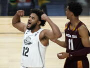 Oregon's LJ Figueroa (12) celebrates after a play against Arizona State during the second half of an NCAA college basketball game in the quarterfinal round of the Pac-12 men's tournament Thursday, March 11, 2021, in Las Vegas.