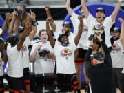Oregon State players celebrate after defeating Colorado in an NCAA college basketball game in the championship of the Pac-12 men's tournament Saturday, March 13, 2021, in Las Vegas.