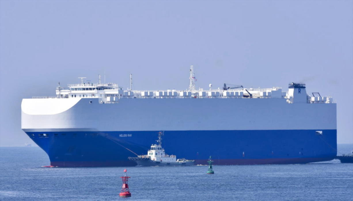 In this Aug. 14, 2020, photo, the vehicle cargo ship Helios Ray is seen at the Port of Chiba in Chiba, Japan. An explosion struck the Israeli-owned Helios Ray as it sailed out of the Middle East on Friday, Feb. 26, 2021, an unexplained blast renewing concerns about ship security in the region amid escalating tensions between the U.S. and Iran.