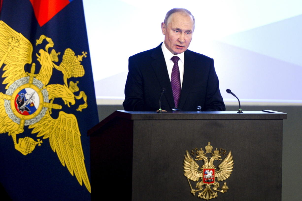 Russian President Vladimir Putin speaks to top Interior Ministry officials in Moscow, Russia, Wednesday, March 3, 2021. Putin urged the Interior Ministry to track down those who draw children to unsanctioned demonstrations.