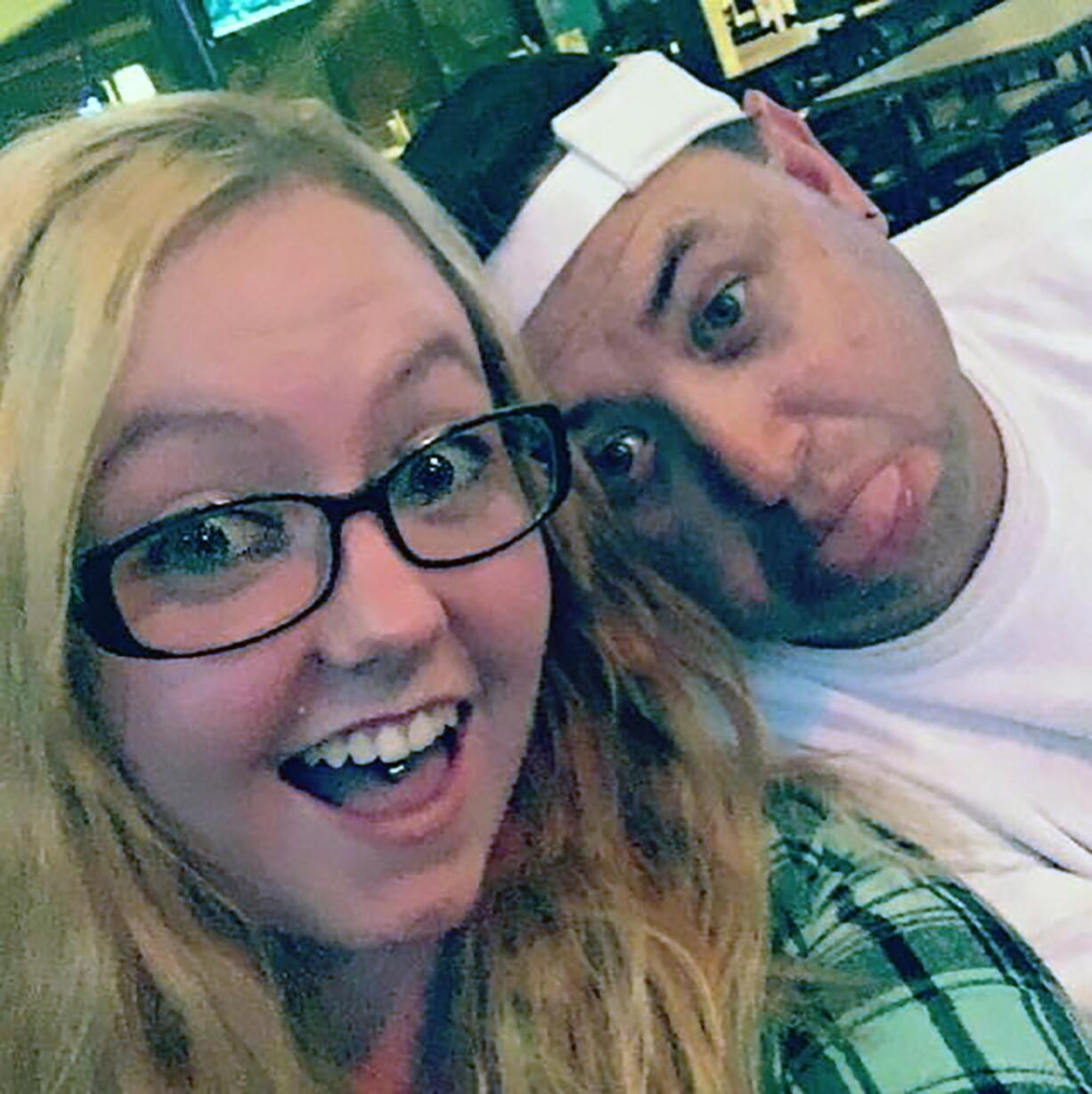 This 2013 photo provided by Robert Olds shows Rikki Olds, left, taking a selfie with her uncle Robert. Rikki Olds, 25, an employee of King Soopers, was slain Monday, March 22, 2021, in the supermarket shooting that killed multiple people in Boulder, Colo. Her grandmother choked up on the phone as she described the young woman she played a large role in raising.