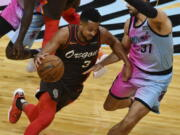 Portland Trail Blazers guard CJ McCollum (3) drives as Miami Heat guard Max Strus (31) defends during the first half of an NBA basketball game Thursday, March 25, 2021, in Miami.