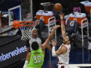 Portland Trail Blazers center Enes Kanter, right, shoots over Minnesota Timberwolves center Karl-Anthony Towns (32) during the first half of an NBA basketball game Saturday, March 13, 2021, in Minneapolis.
