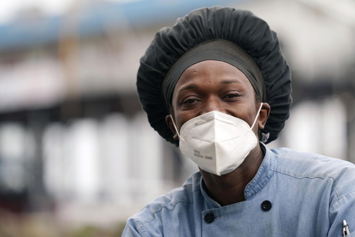 Leo Carney, kitchen manager at McElroy's Harbor House in Biloxi on the Mississippi Gulf Coast, said the removal of coronavirus restrictions will disproportionately impact Black residents -- many of whom are essential workers, Friday, March 5, 2021. Carney said he would feel better with restrictions being removed if essential workers had access to the coronavirus vaccine. (AP Photo/Rogelio V.