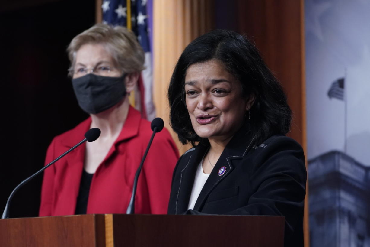 Rep. Pramila Jayapal, D-Wash., right, with Sen. Elizabeth Warren, D-Mass., at left, speaks during a news conference on Capitol Hill in Washington, Monday, March 1, 2021, to unveil a proposed Ultra-Millionaire Tax Act.