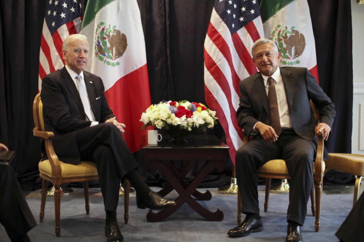 FILE - Then-U.S. Vice President Joe Biden, left, poses for photos with then-Mexican presidential candidate Andres Manuel Lopez Obrador in Mexico City, Monday March 5, 2012. President Biden is planning a virtual meeting with Mexican President Obrador. The meeting, on Monday, March 1, 2021, is a chance for the pair to talk more fully about migration, treating the coronavirus and cooperating on economic and national security issues.