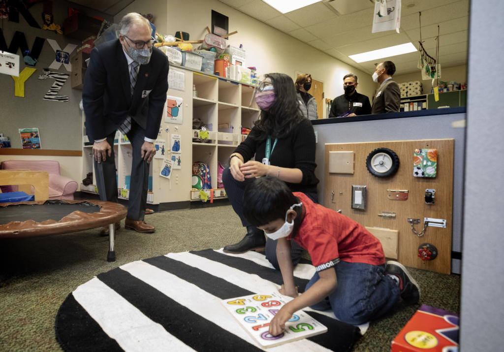 Washington State Governor Jay Inslee speaks with special ed Pre-K teacher Michelle Ling in her classroom at Phantom Lake Elementary School in Bellevue, Wash. Tuesday, March 2, 2021. (Ellen M.