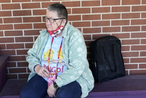 Pat Brown waits outside the Don Bosco Senior Center in Kansas City, Mo., Wednesday, March 3, 2021. Brown knows she needs the vaccine because her asthma and diabetes put her at higher risk of serious COVID-19 complications. But Wall hasn't attempted to schedule an appointment and didn't even know if they were being offered in her area yet; she says she is too overwhelmed.