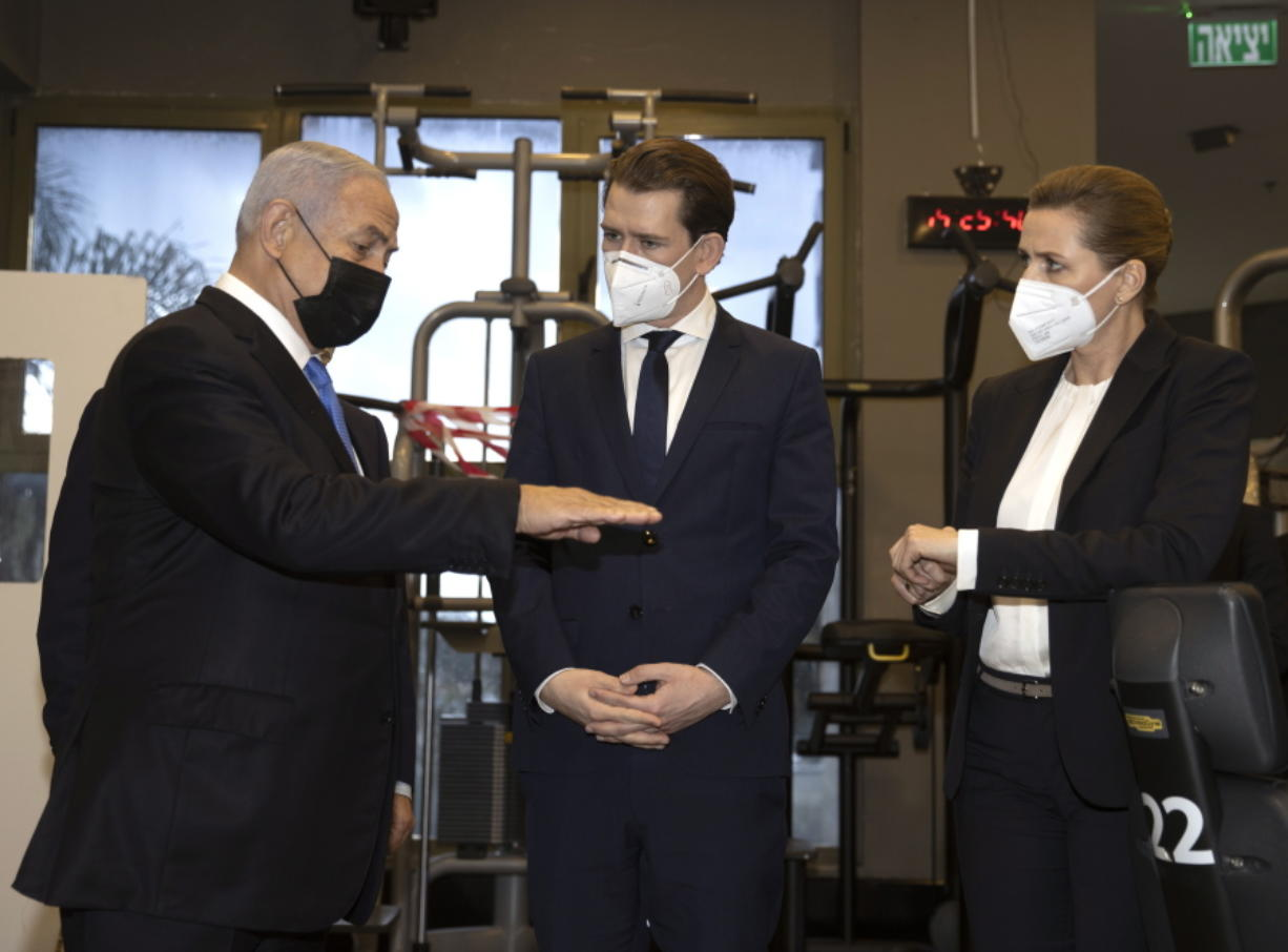"""Israeli Prime Minister Benjamin Netanyahu, left, visits a fitness gym with Austrian Chancellor Sebastian Kurz, center, and Danish Prime Minister Mette Frederiksen, to observe how the """"Green Pass,"""" for citizens vaccinated against COVID-19, is used, in Modi'in, Israel, Thursday, March 4, 2021. Frederiksen and Kurz are on a short visit to Israel for to pursue the possibilities for closer cooperation on COVID-19 and vaccines."""