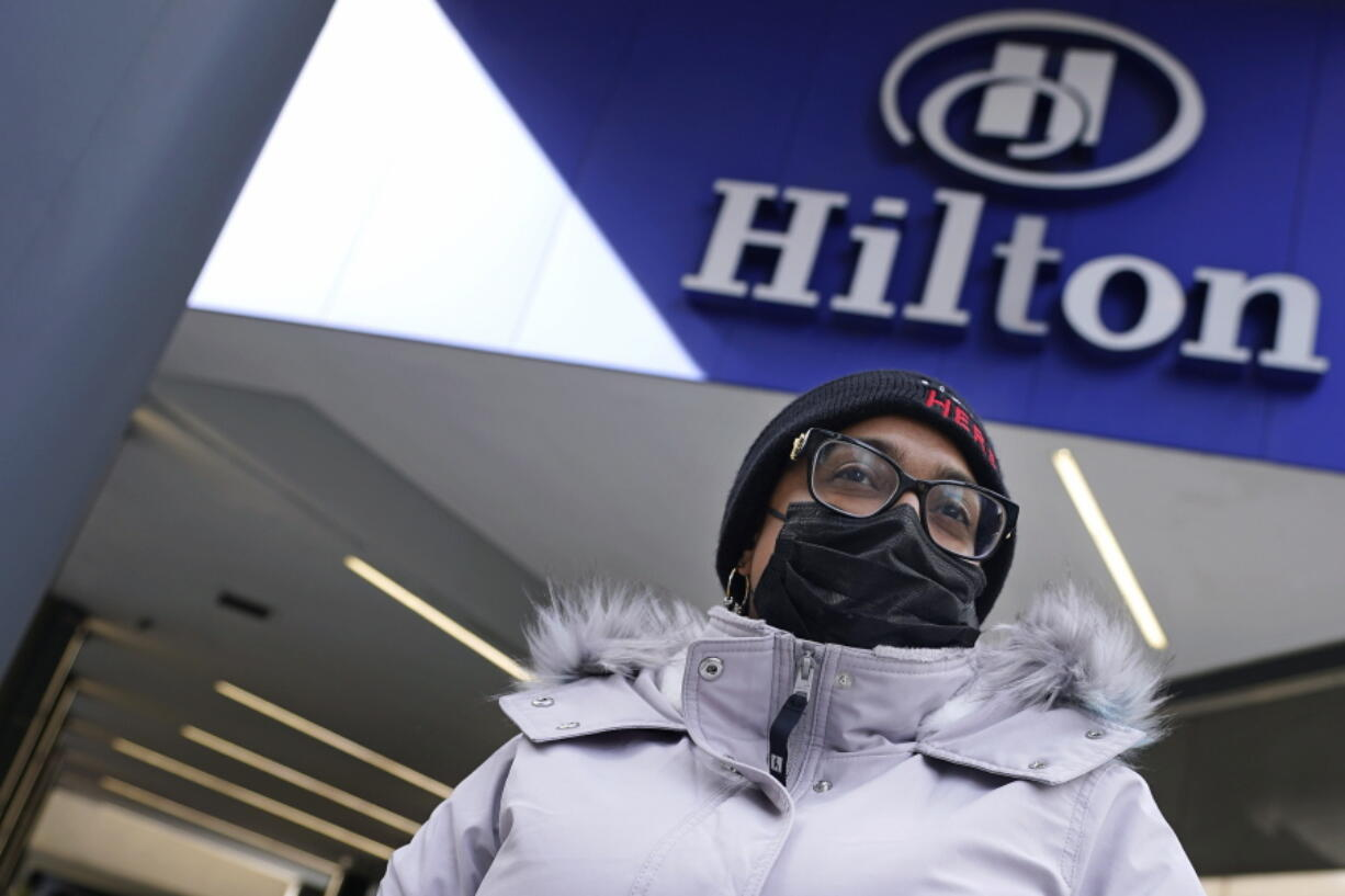 Hotel housekeeper Esther Montanez poses outside the Hilton Back Bay, Friday, March 5, 2021, in Boston. Montanez refuses to give up hope of returning to her cleaning job at the hotel, which she held for six years until being furloughed since March 2020 due to the COVID-19 virus outbreak.