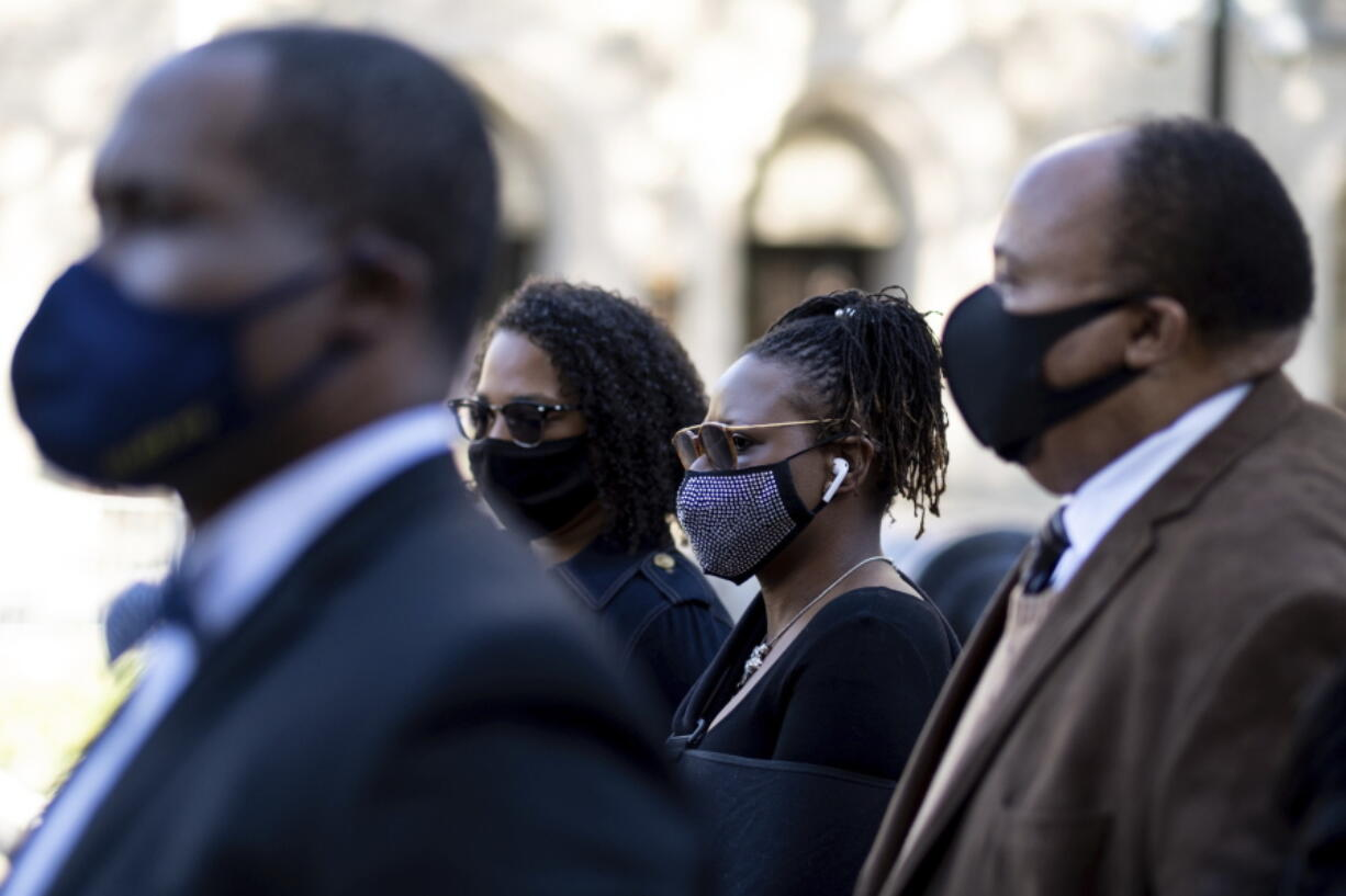 Georgia State Rep. Park Cannon, D-Atlanta,, center, walks beside Martin Luther King, III, as she returns to the State Capitol in Atlanta on Monday morning, March 29, 2021 after being arrested last week for knocking on the governor's office door as he signed voting legislation.