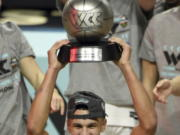 Gonzaga guard Jalen Suggs holds his most outstanding player award with his team after they defeated BYU in an NCAA college basketball game for the West Coast Conference men's tournament championship Tuesday, March 9, 2021, in Las Vegas.