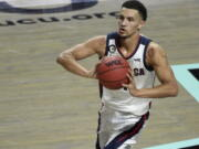 Gonzaga guard Joel Ayayi (11) looks to pass the ball against Saint Mary's during the first half of an NCAA semifinal college basketball game against Saint Mary's at the West Coast Conference tournament Monday, March 8, 2021, in Las Vegas.