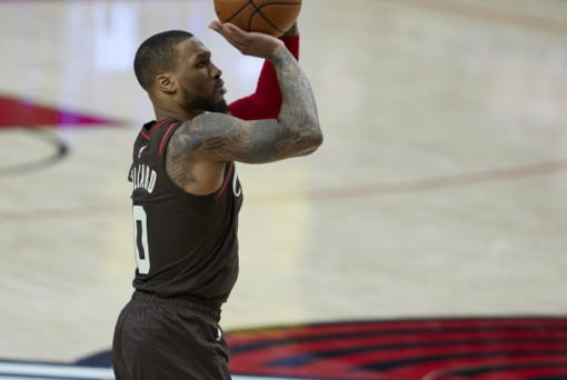 Portland Trail Blazers guard Damian Lillard shoots a 3-pointer against the Golden State Warriors during the second half of an NBA basketball game in Portland, Ore., Wednesday, March 3, 2021.