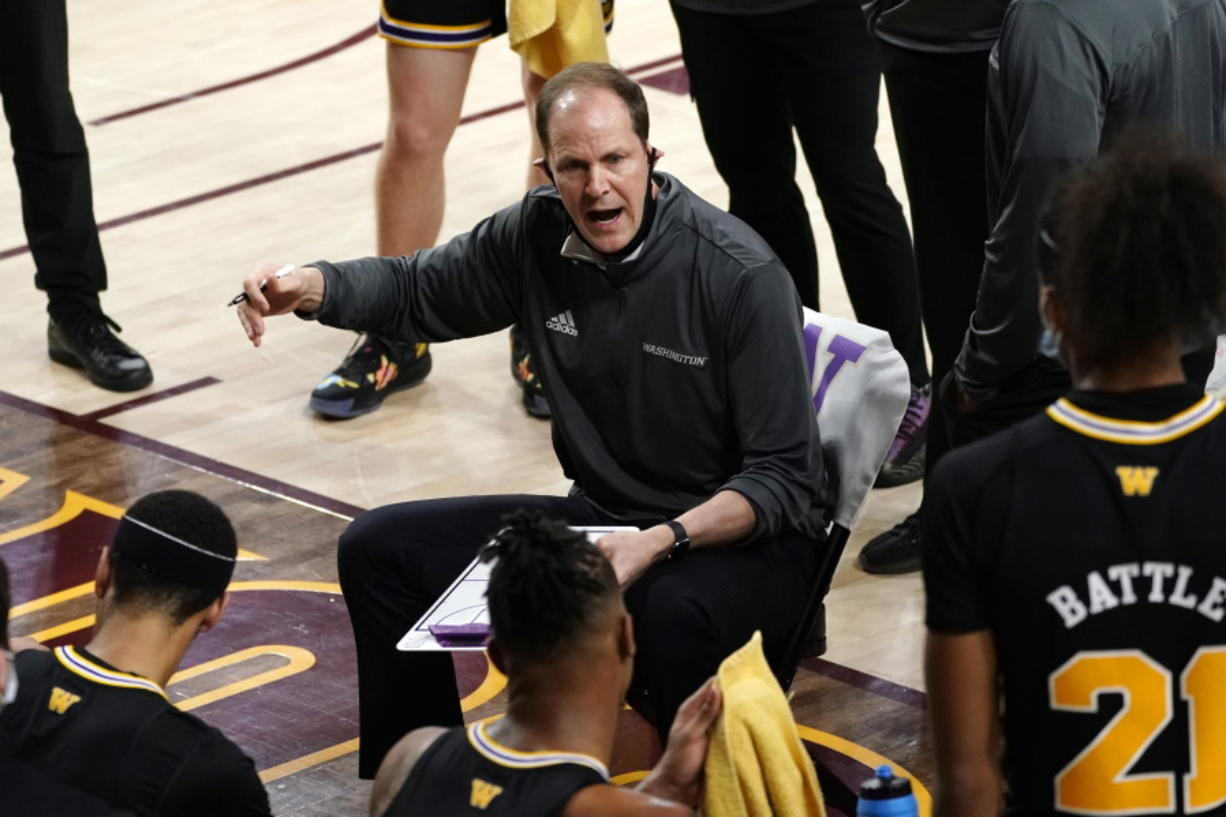 Washington coach Mike Hopkins talks to the team during the first half of an NCAA college basketball game against Arizona State, Tuesday, Feb. 23, 2021, in Tempe, Ariz.