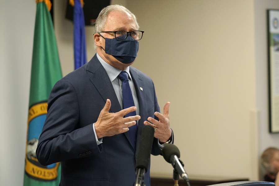 Washington Gov. Jay Inslee speaks Monday, March 22, 2021, at a news conference at Renton City Hall in Renton, Wash., south of Seattle. Inslee and other leaders gathered to denounce recent acts of violence and harassment targeted at Asians and Asian communities. (AP Photo/Ted S.