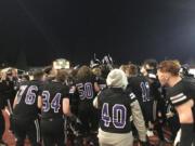 Heritage players celebrate their 30-17 win Friday night at McKenzie Stadium.