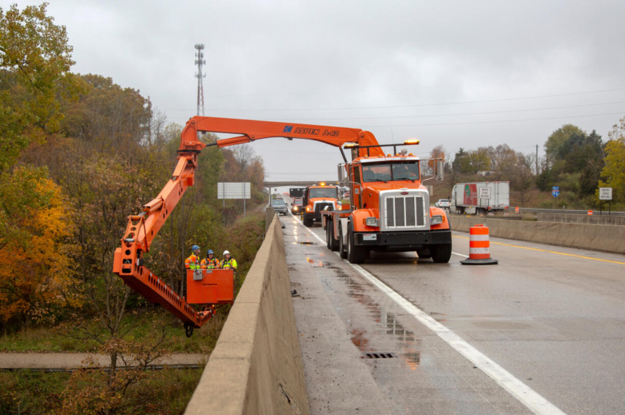 Critical infrastructure improvements, such as this work on a bridge over the Grand River near Portland, Michigan, may find funding through surplus state money in addition to any federal dollars used.