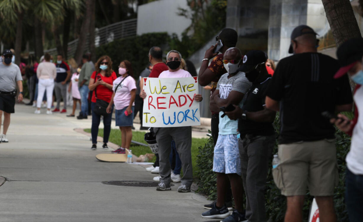 Furloughed hospitality workers from the shuttered Diplomat Beach Resort in Hollywood, Fla., demonstrate to preserve their jobs as management mulls the hotel's reopening.