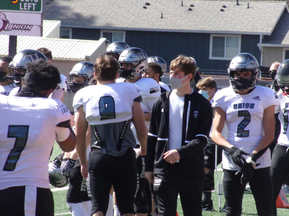 Liam Mallory (in black) walks on the sidelines with his Union teammates in a game against Heritage on March 27.