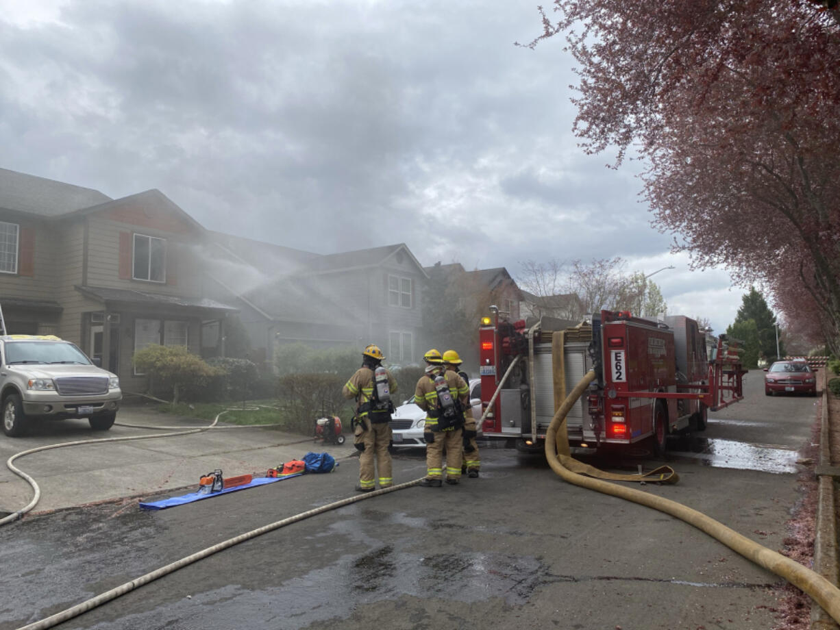 Firefighters respond to a house fire Wednesday afternoon on Northwest 34th Avenue in Felida.