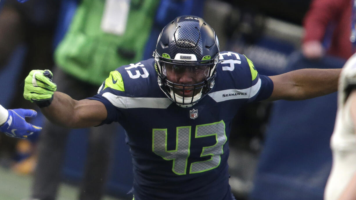 Seattle Seahawks defensive end Carlos Dunlap II (43) in action against the Los Angeles Rams during the first half of an NFL football game, Sunday, Dec. 27, 2020, in Seattle.