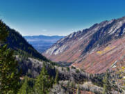 View of the trail mountain landscape toward Salt Lake Valley in Little Cottonwood Canyon, Wasatch Rocky Mountain Range in Utah.