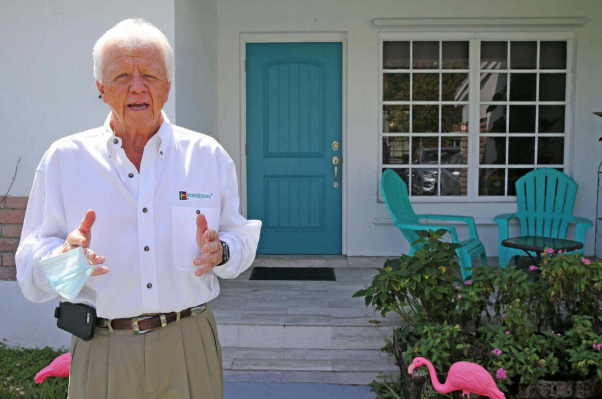 Don Cameron, owner of Hi-Land Properties, a We Buy Ugly Houses franchise based in South Florida, stands outside a Miami home on March 18, 2021.