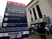 Fans line up in front of Yankee Stadium in New York on April 1, 2021. Schools, businesses and sports and entertainment venues are considering rapid COVID-19 tests as a requirement for entry. (Timothy A.